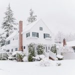 house in winter with frozen pipes