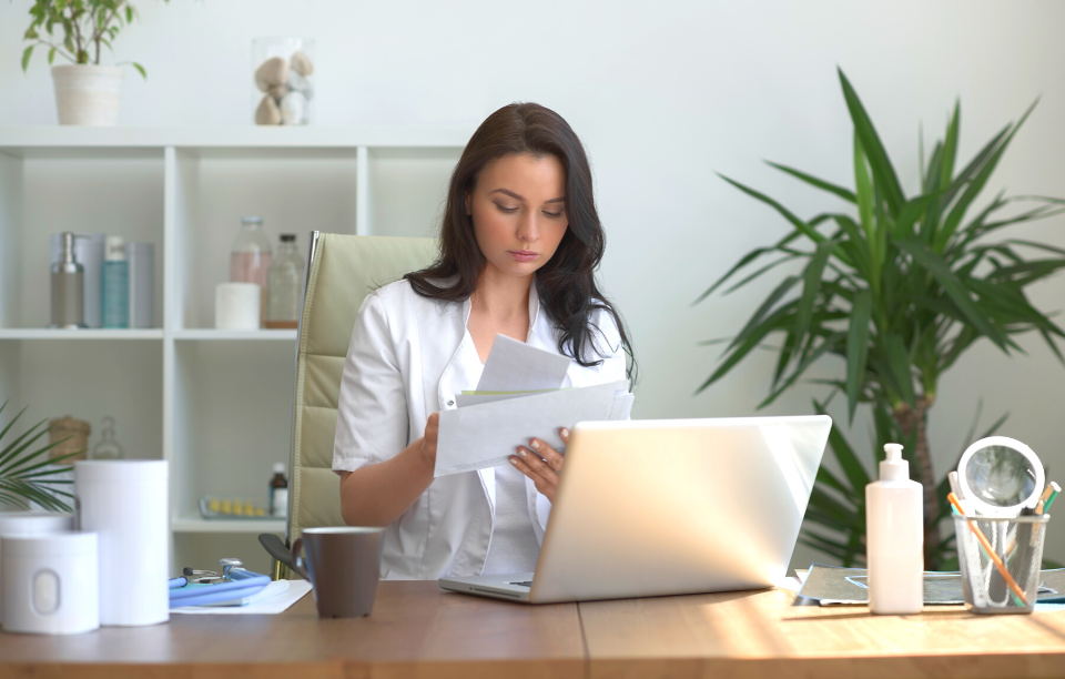 how to tell tenant need to raise the rent image: woman in front of laptop frowning at letter in her hand