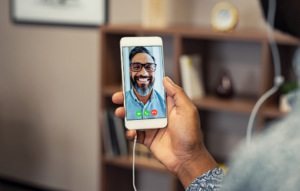 set up virtual viewings: image of a woman on a video call with a man with glasses