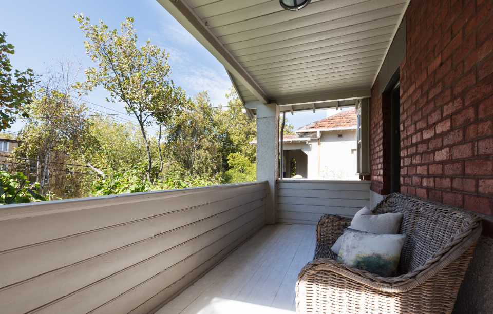 apartment amenities image: picture of a front porch of a brick house