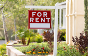 """red """"for rent"""" sign used on houses or apartments for rental listings"""