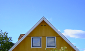 negotiate with a wholesaler hero image of a house with two windows, in the background is a blue sky