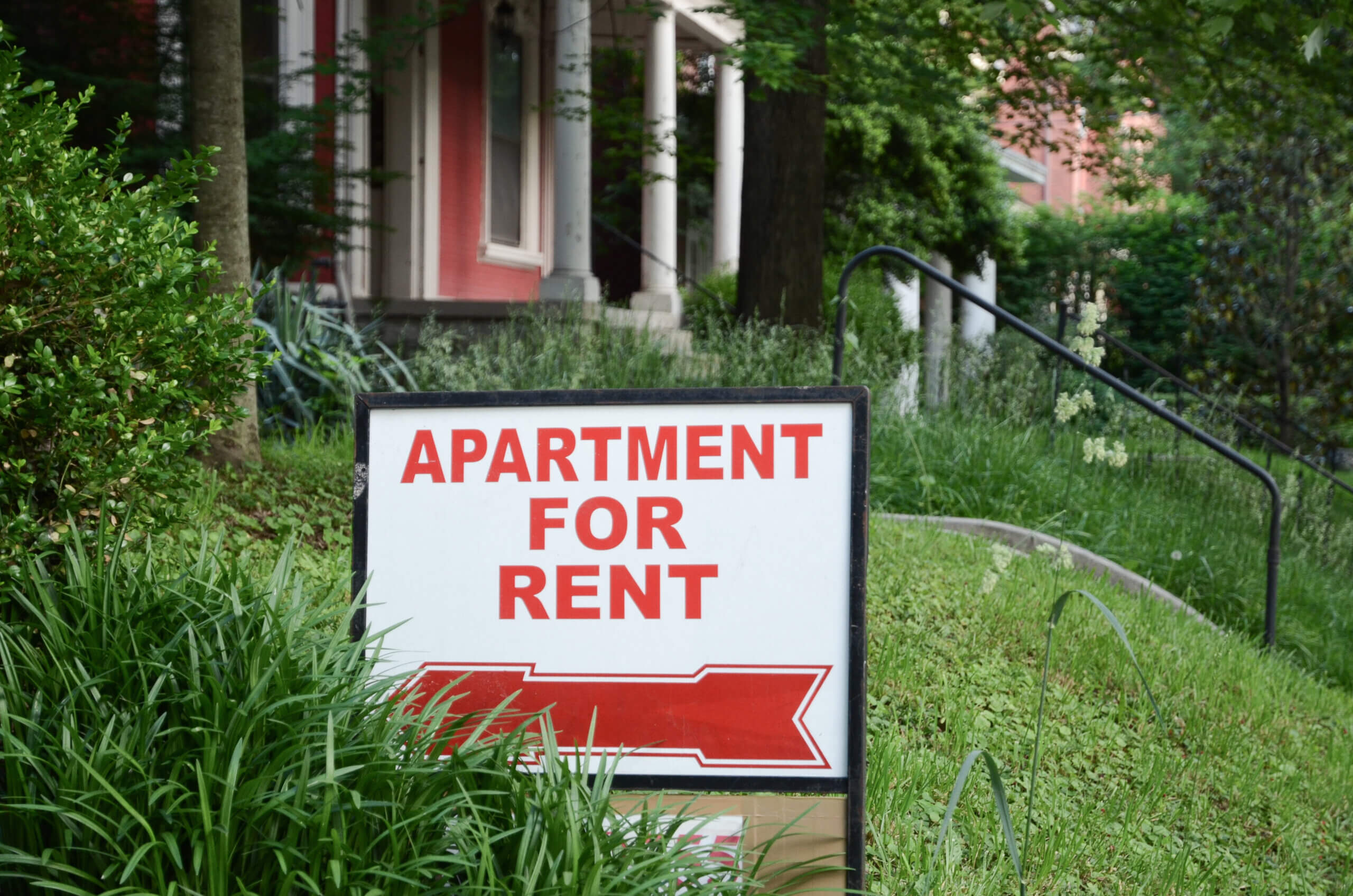 apartment for rent sign in yard